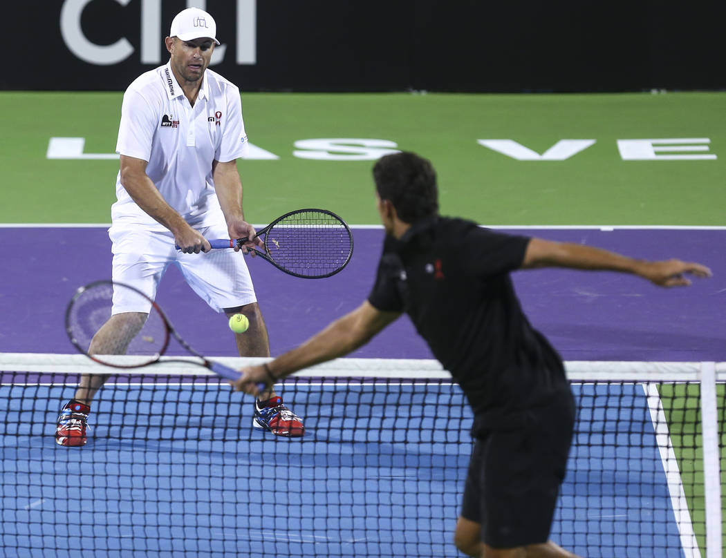 Andy Roddick, left, and Mark Philippoussis compete during a World Team Tennis charity exhibitio ...