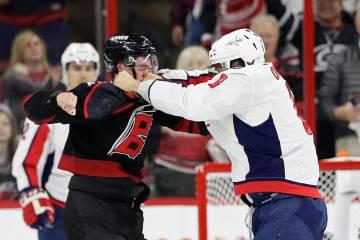 Washington Capitals' Alex Ovechkin, right, of Russia, punches Carolina Hurricanes' Andrei Svech ...