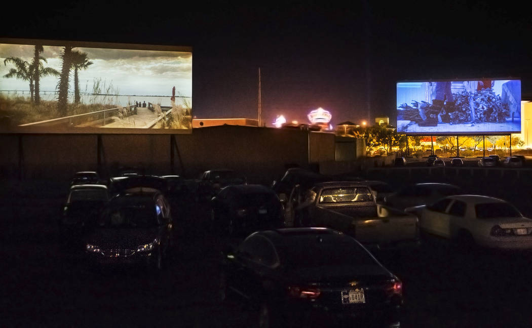 Patrons watch Geostorm, left, and Bad Moms Christmas at the Las Vegas Drive In on Sunday, Nov. ...