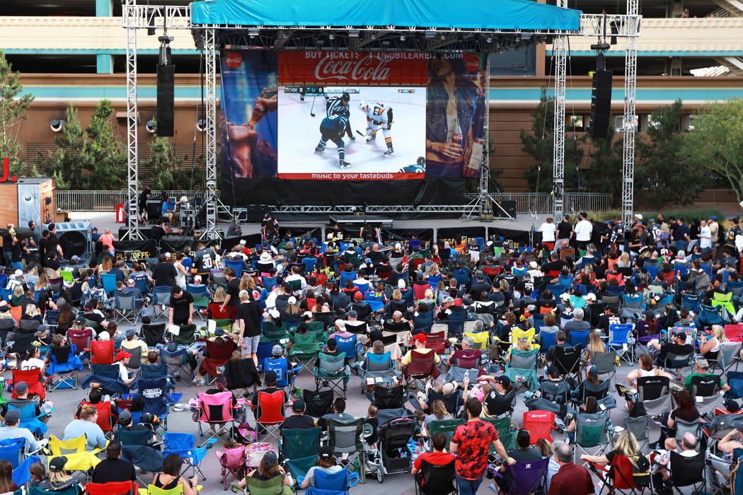 Fans attend a Vegas Golden Knights watch party for game six of the Stanley Cup playoffs outside ...