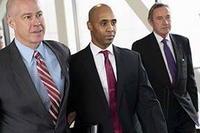 Former Minneapolis police officer Mohamed Noor, center, leaves the Hennepin County Government C ...