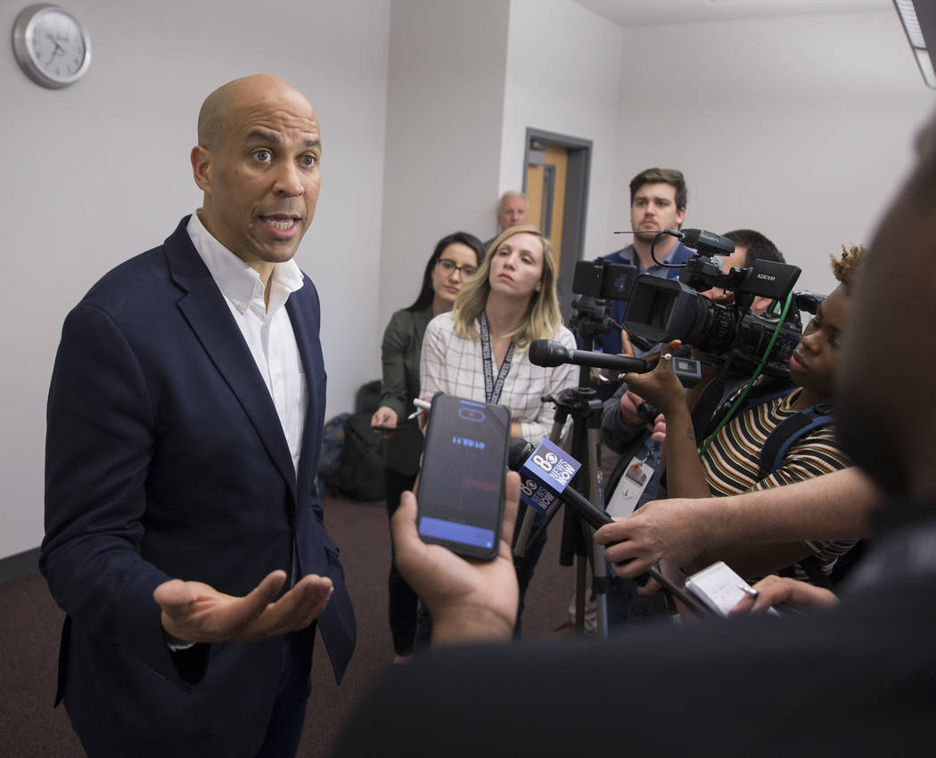 Democratic presidential candidate Sen. Cory Booker, D-N.J. takes questions from the media befor ...