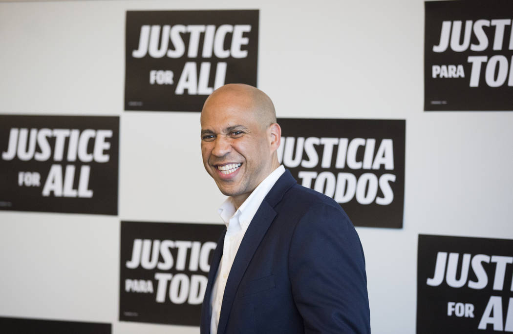 Democratic presidential candidate Sen. Cory Booker, D-N.J., shares a laugh with the crowd durin ...