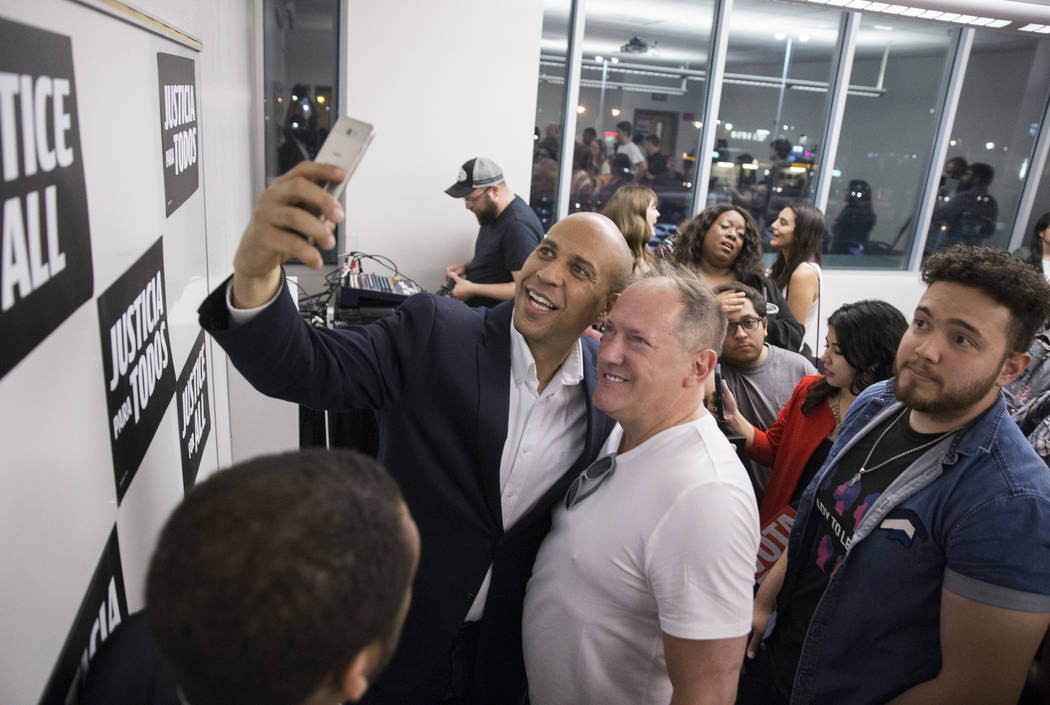 Democratic presidential candidate Sen. Cory Booker, left, D-N.J., takes a photo with Ed Russini ...
