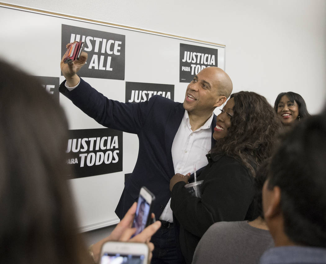 Democratic presidential candidate Sen. Cory Booker, left, D-N.J., takes a photo with Shannon Ch ...
