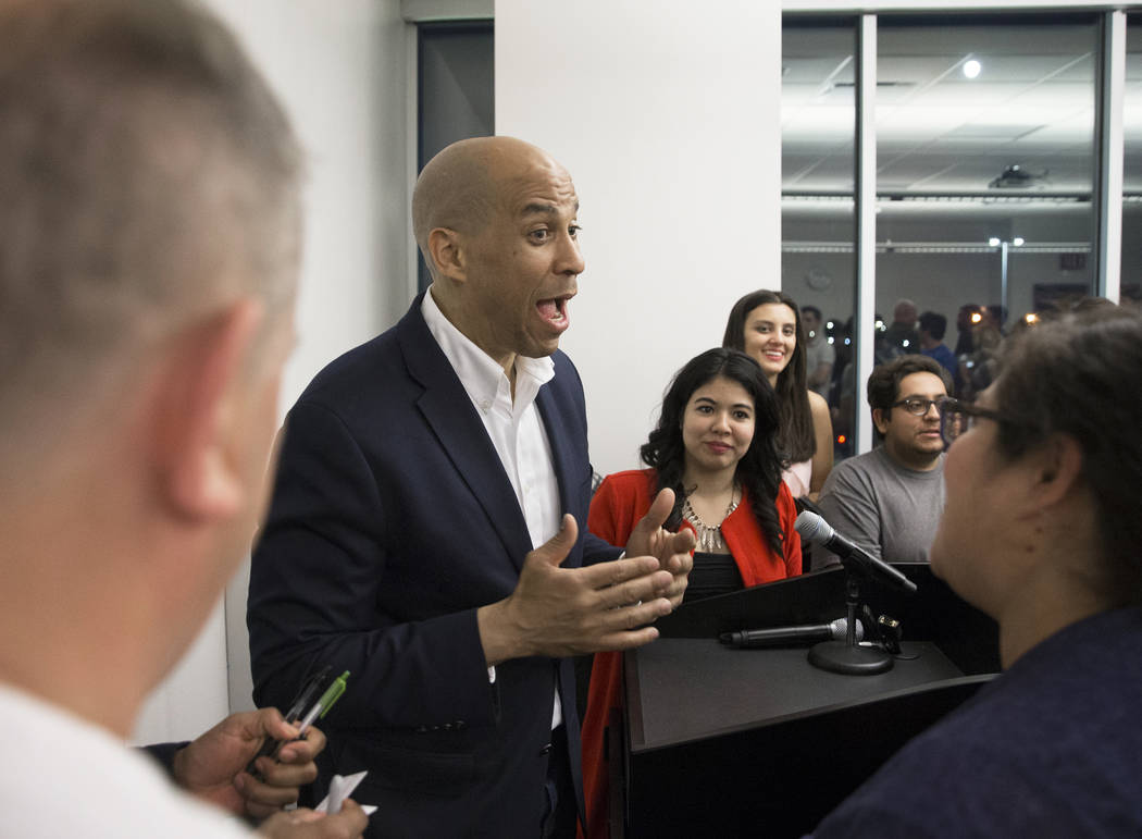Democratic presidential candidate Sen. Cory Booker, D-N.J., speaks to supporters at the conclus ...