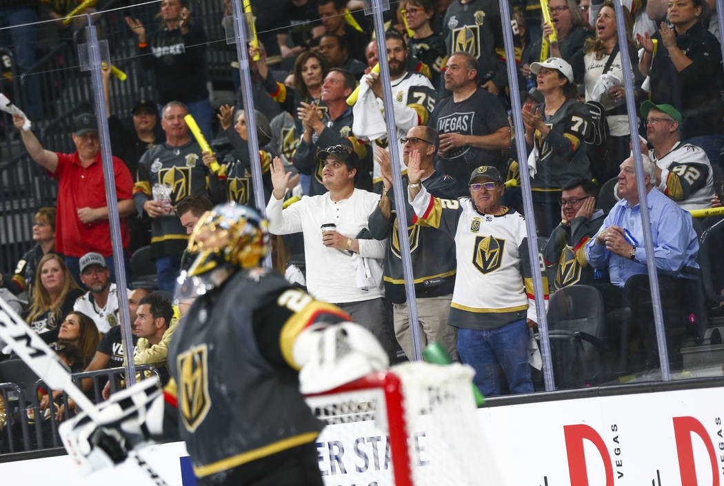 Golden Knights fans celebrate a block by Golden Knights goaltender Marc-Andre Fleury (29) durin ...