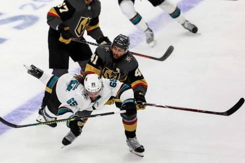 Vegas Golden Knights center Pierre-Edouard Bellemare (41) pushes San Jose Sharks defenseman Eri ...