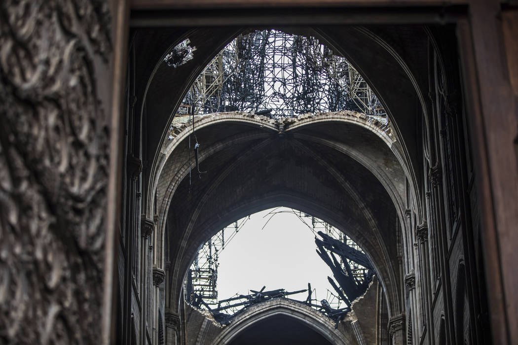 Holes seen in the dome inside the damaged Notre Dame cathedral in Paris, Tuesday, April 16, 201 ...