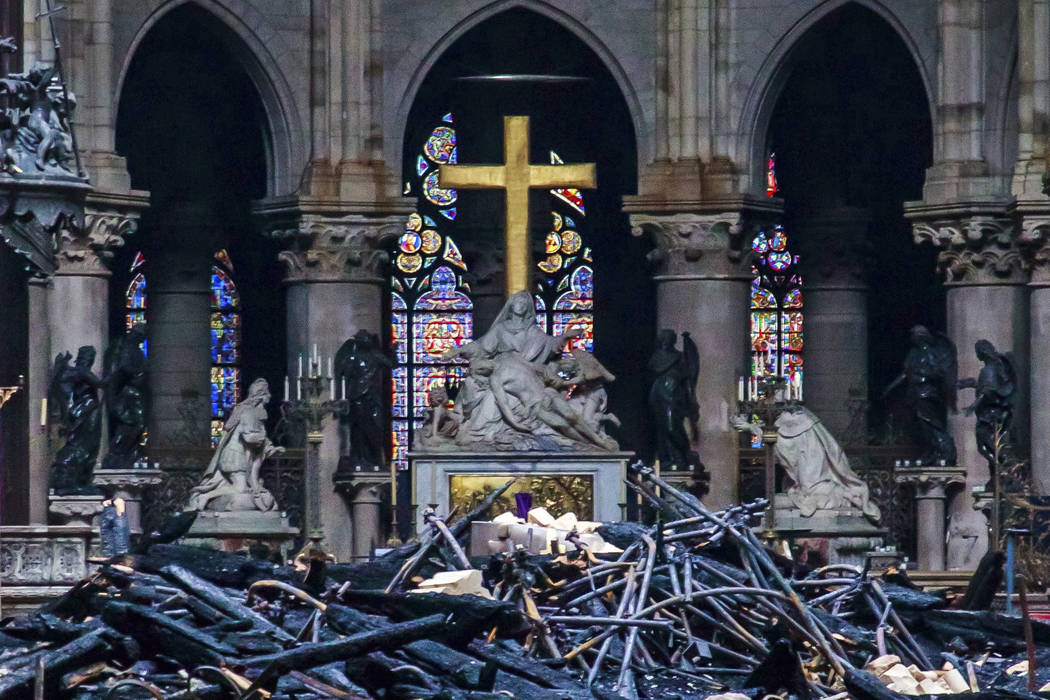 Debris is seen inside Notre Dame cathedral in Paris, Tuesday, April 16, 2019. Firefighters decl ...