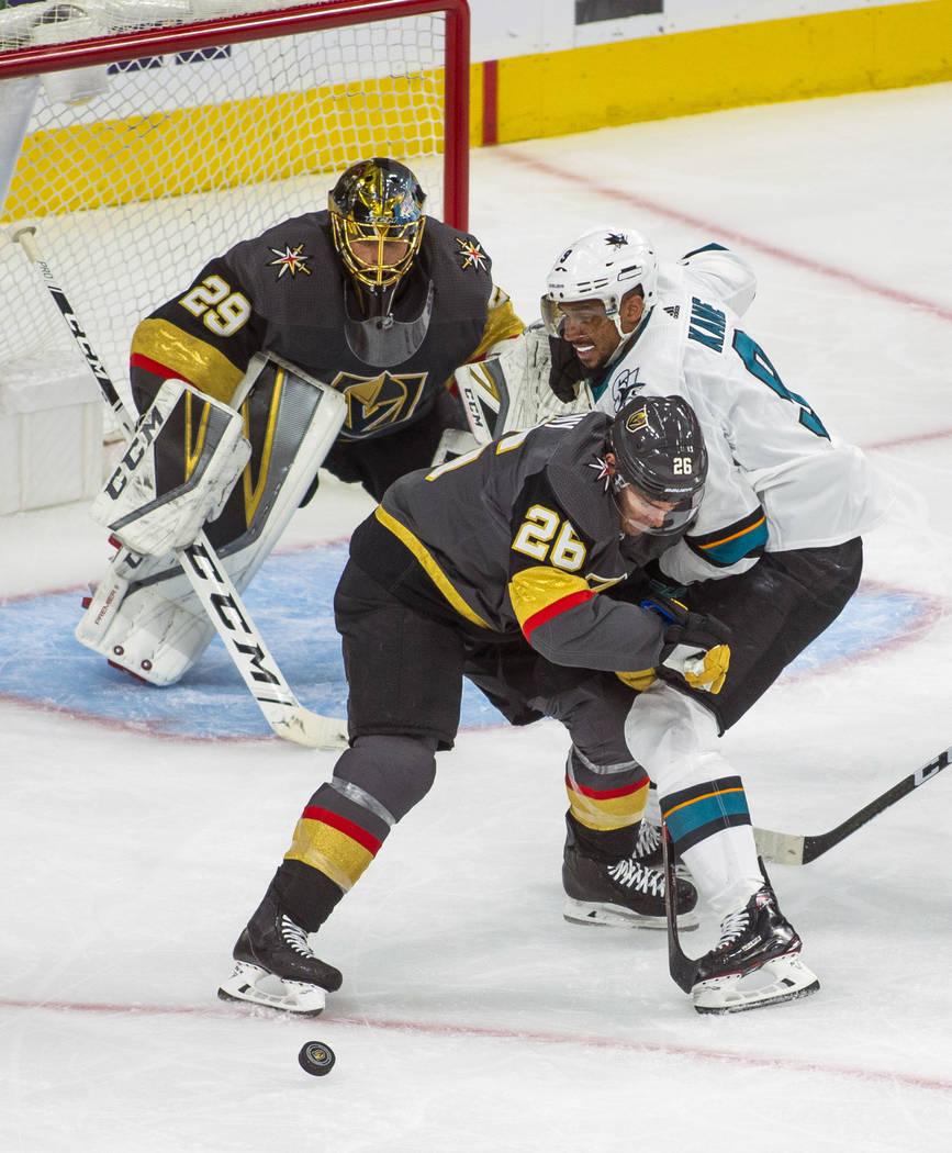 Golden Knights center Paul Stastny (26) defends the net from San Jose Sharks left wing Evander ...