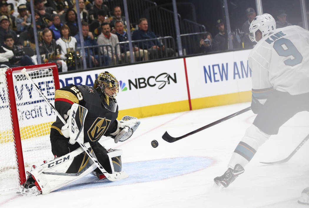 Golden Knights goaltender Marc-Andre Fleury (29) blocks a shot from San Jose Sharks left wing E ...