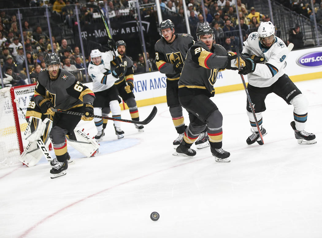 Golden Knights center Paul Stastny (26) and San Jose Sharks left wing Evander Kane (9) watch th ...