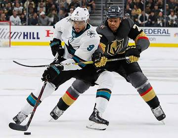 San Jose Sharks left wing Evander Kane (9) tries to skate around Vegas Golden Knights right win ...