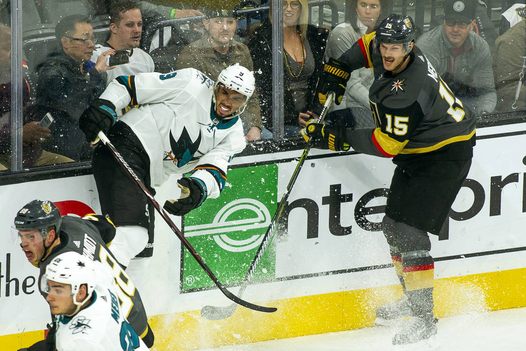 San Jose Sharks left wing Evander Kane (9) crashes the boards on a drive with Golden Knights de ...