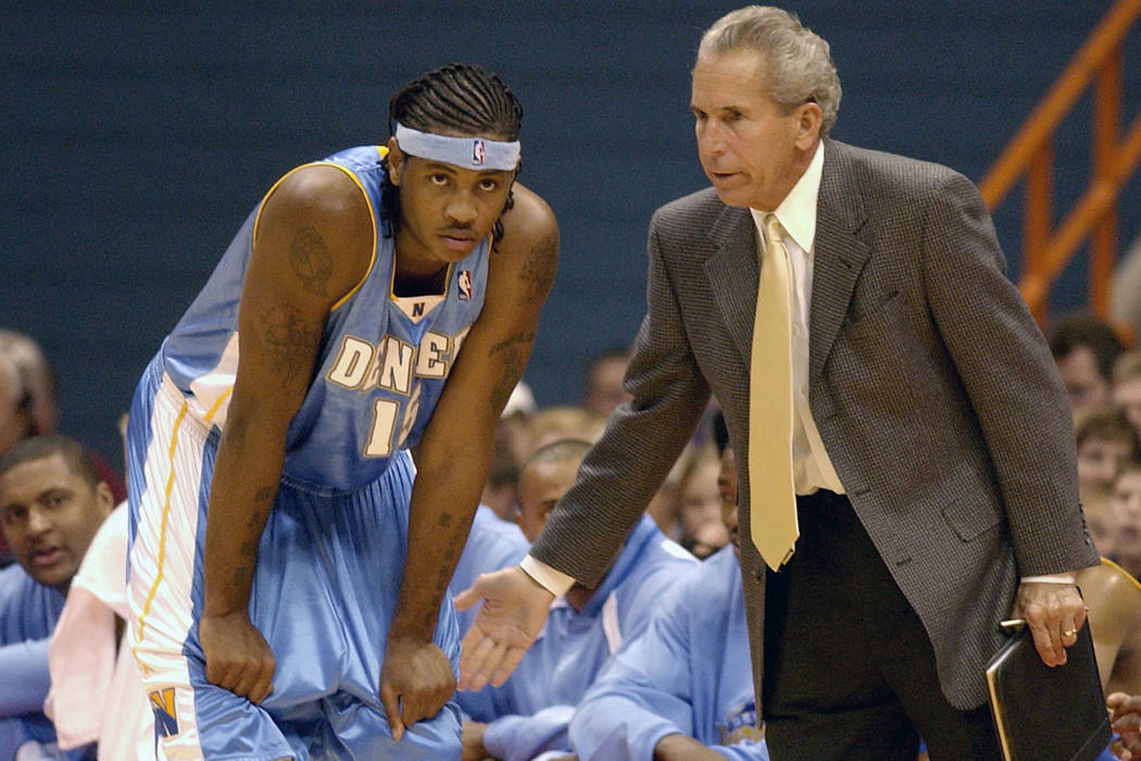 FILE - In this Sunday, Oct. 19, 2003, file photo, Denver Nuggets' Carmelo Anthony, left, receiv ...