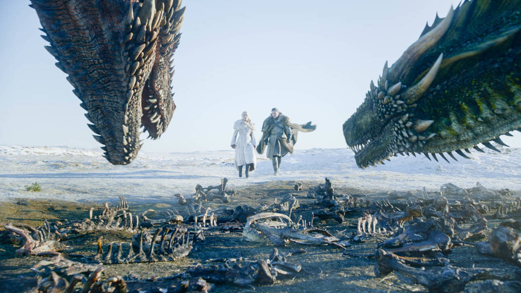 """This image released by HBO shows Emilia Clarke, left, and Kit Harington in a scene from """" ..."""