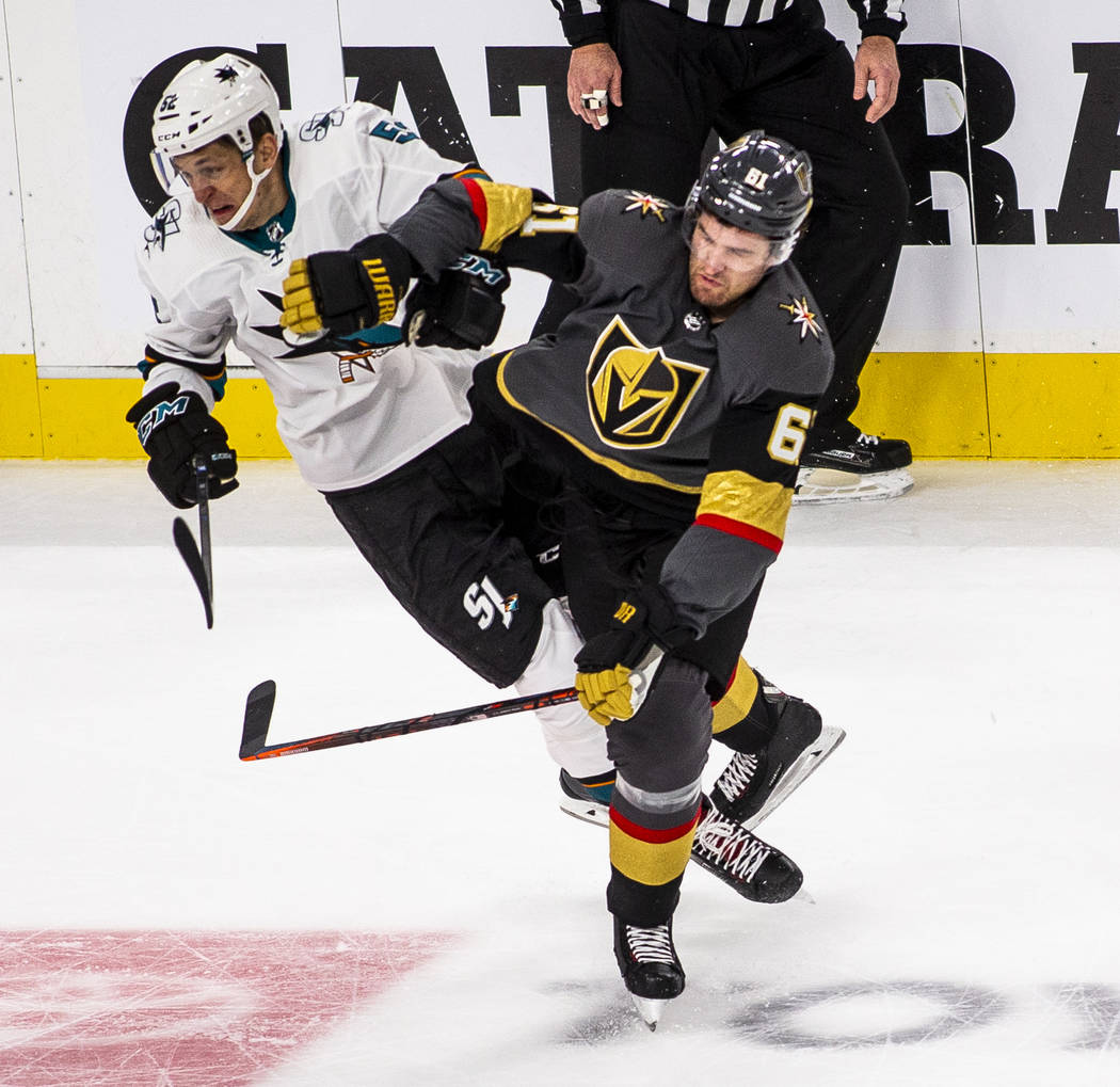 San Jose Sharks center Lukas Radil (52) collides with Golden Knights right wing Mark Stone (61) ...