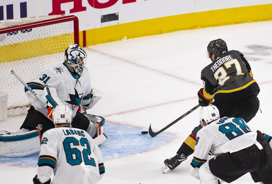 Golden Knights defenseman Shea Theodore (27) readies to score on San Jose Sharks goaltender Mar ...