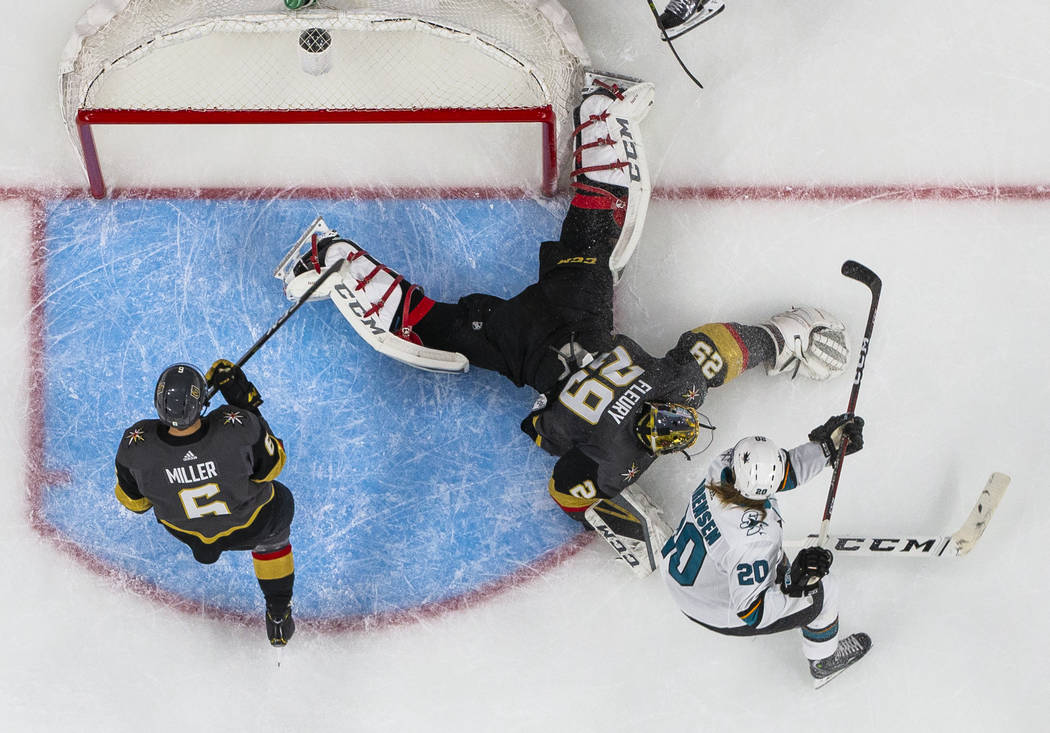 Golden Knights goaltender Marc-Andre Fleury (29) pounces on a shot by San Jose Sharks left wing ...