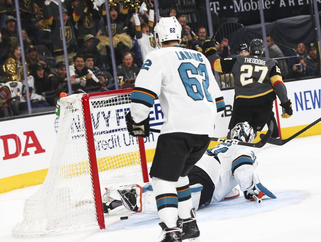 Golden Knights defenseman Shea Theodore (27) scores a goal past San Jose Sharks goaltender Mart ...