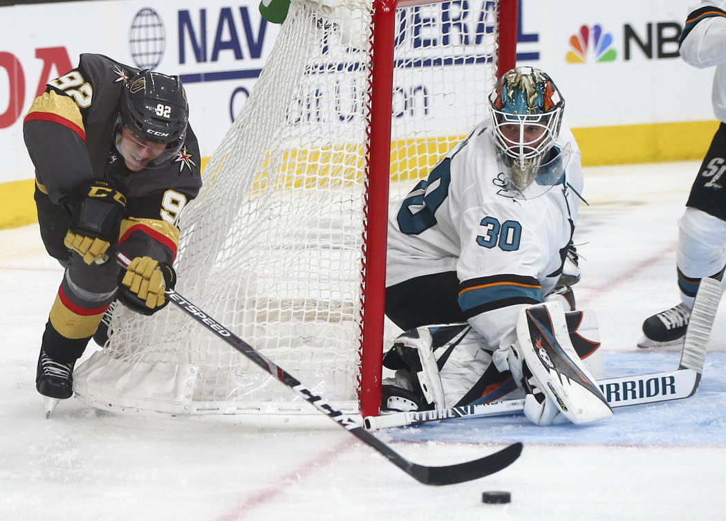 Golden Knights left wing Tomas Nosek (92) tries to score against San Jose Sharks goaltender Aar ...