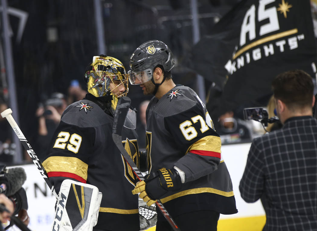 Golden Knights left wing Max Pacioretty (67) celebrates with goaltender Marc-Andre Fleury (29) ...