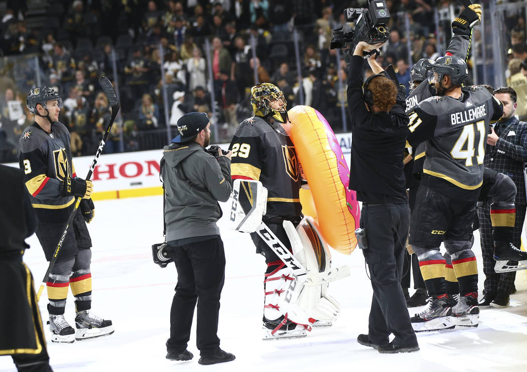 Golden Knights goaltender Marc-Andre Fleury (29) holds an inflatable donut after leading his te ...