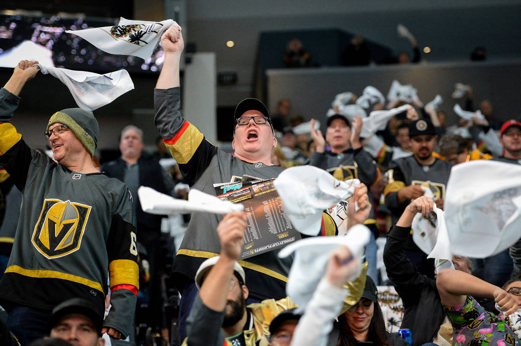 Fans cheer on the Golden Knights as they warm up before they face off against the San Jose Shar ...