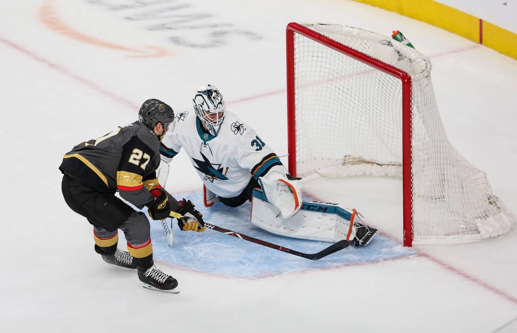 Vegas Golden Knights defenseman Shea Theodore (27) scores against San Jose Sharks goaltender Ma ...