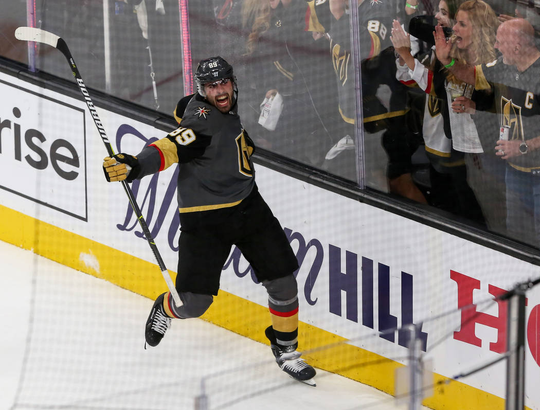 Vegas Golden Knights right wing Alex Tuch (89) celebrates after scoring against the San Jose Sh ...