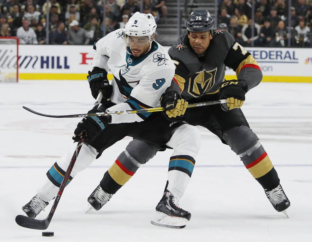 San Jose Sharks left wing Evander Kane (9) tries to skate around Vegas Golden Knights right win ...