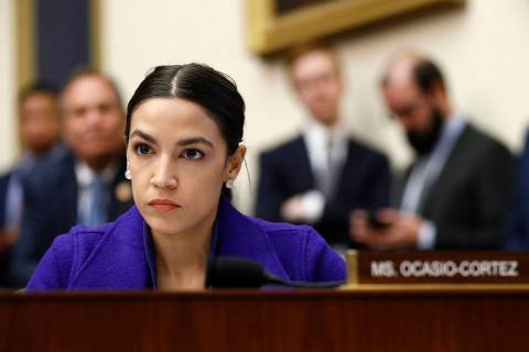 In this Wednesday, April 10, 2019, file photo, Rep. Alexandria Ocasio-Cortez, D-N.Y., listens d ...