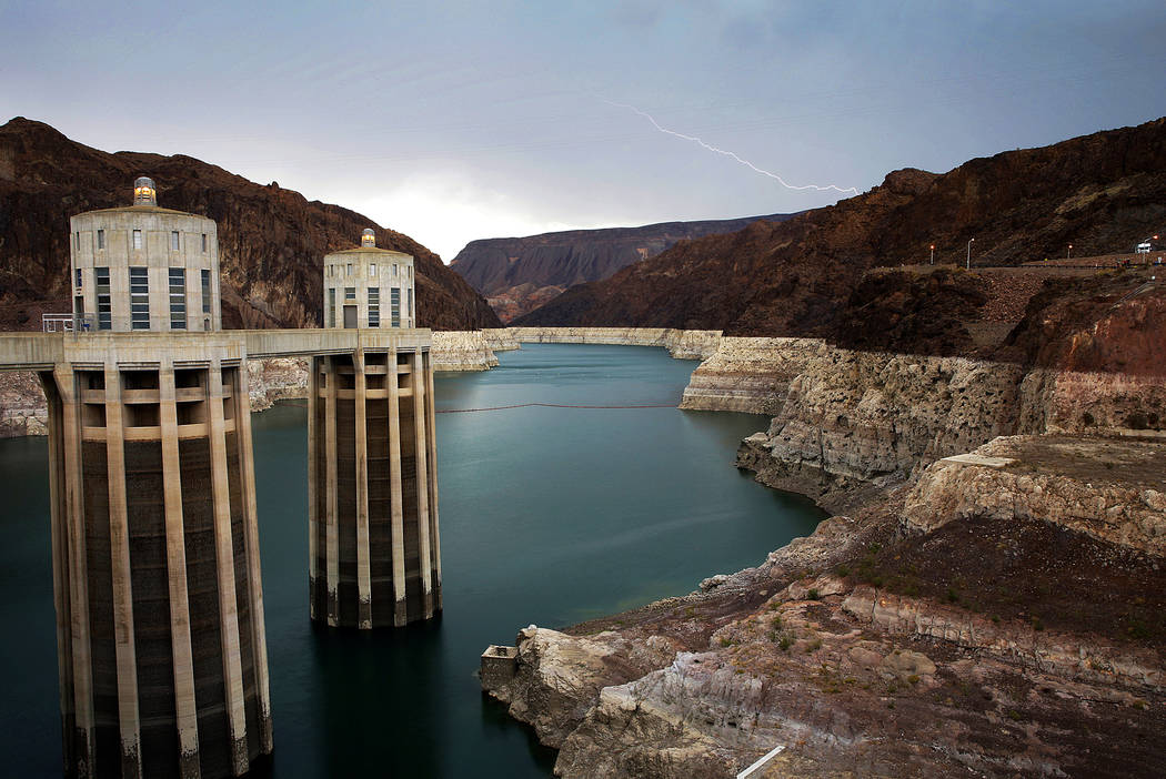 FILE - In this July 28, 2014, file photo, lightning strikes over Lake Mead near Hoover Dam that ...