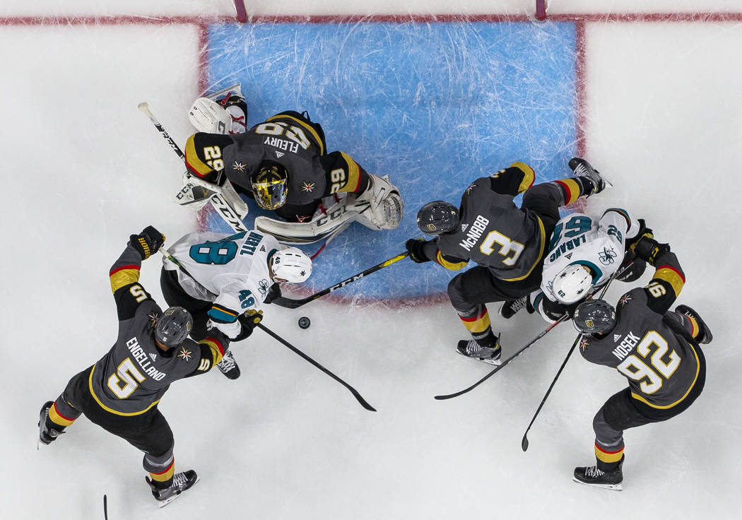 Golden Knights goaltender Marc-Andre Fleury (29) defends the net from San Jose Sharks center To ...