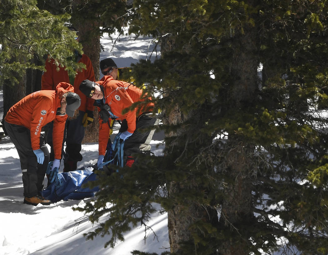 Members of an Alpine Rescue Team carry out the body of 18-year-old Sol Pais, near Echo Lake Cam ...