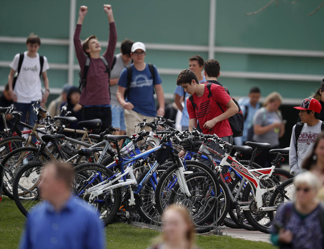 Students leave Columbine High School late Tuesday, April 16, 2019, in Littleton, Colo. Followin ...
