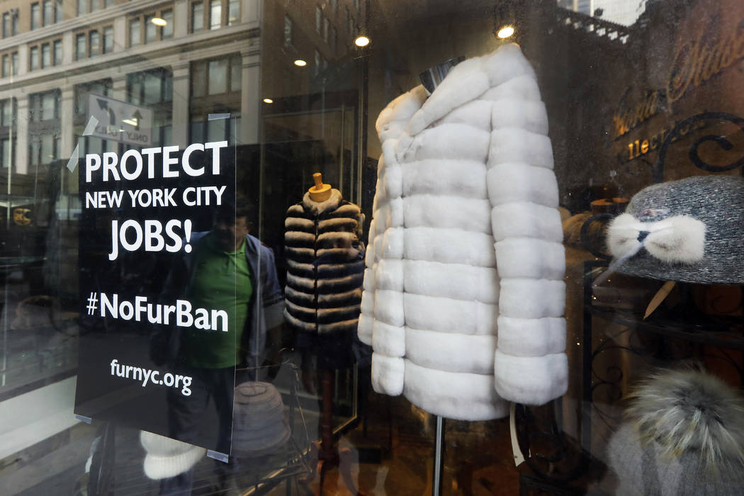A sign by furnyc.org in the window of Victoria Stass Collection in New York's fur district on A ...
