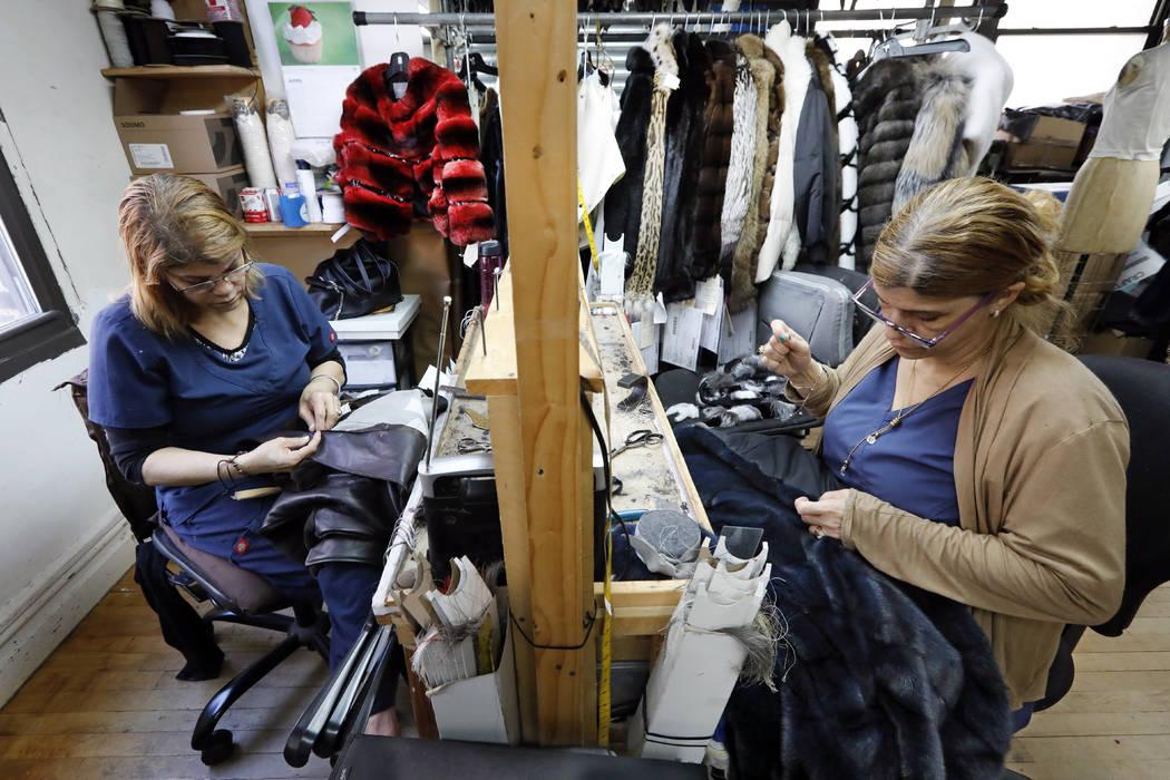 Samstresses Sonia Genao, left, and Juana Rodrize work April 10, 2019, on coats at Pologeorgis F ...
