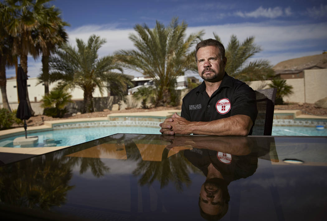 Former SWAT member Grant Whitus poses for a portrait April 9, 2019, at his home in Lake Havasu ...