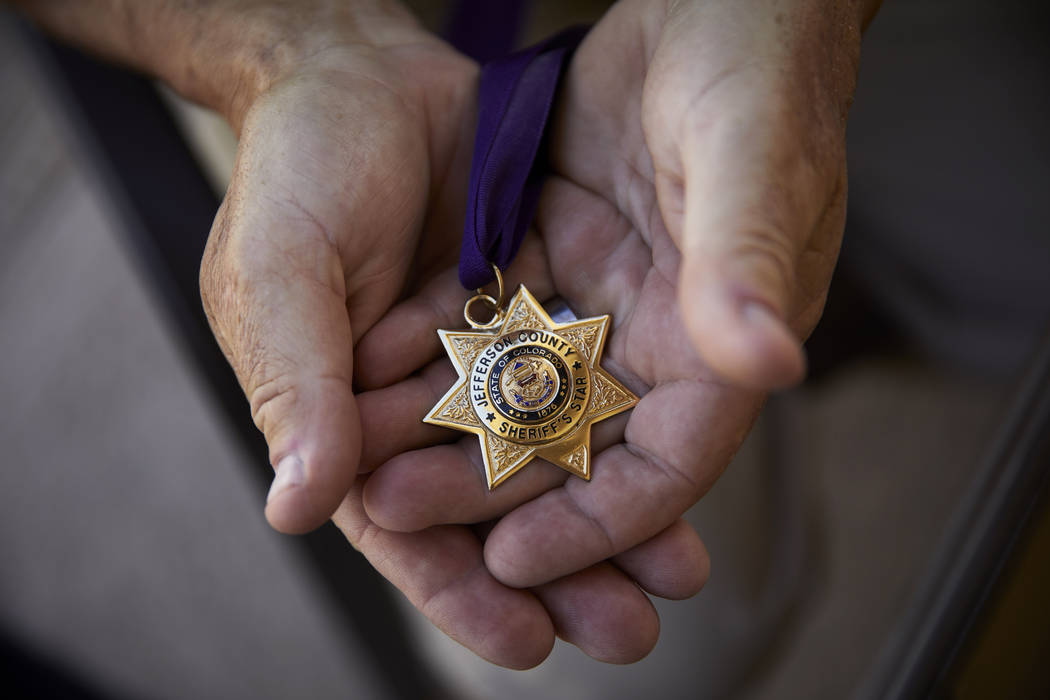 Grant Whitus holds the Jefferson County Sheriff's Star at his home in Lake Havasu City, Ariz. o ...