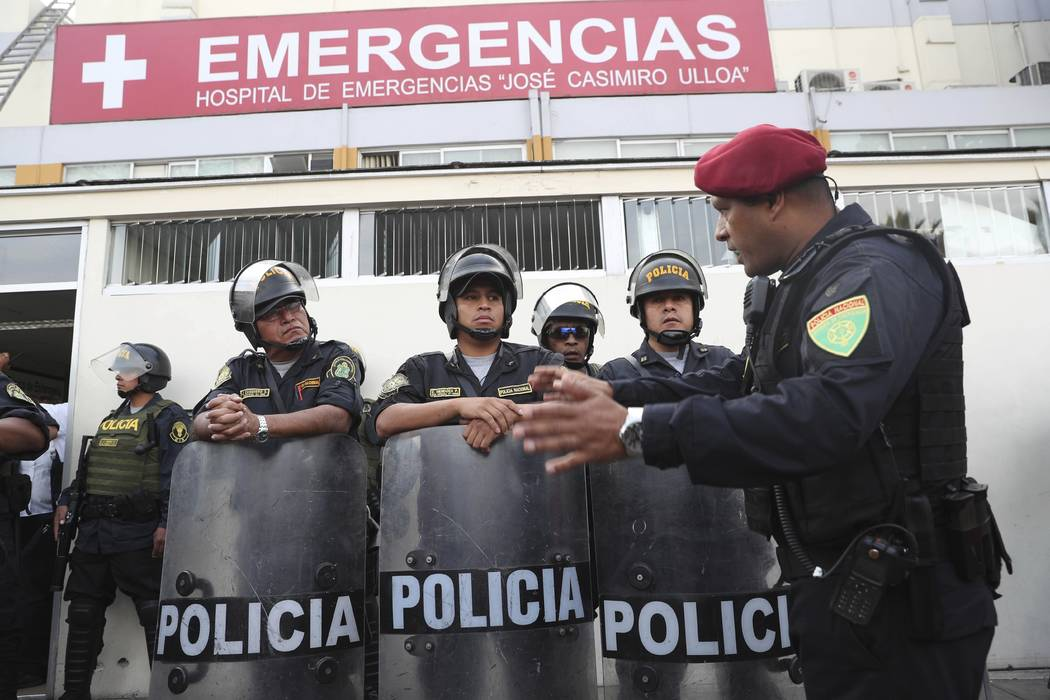 Peru's police officers stand guard at the emergency hospital Casimiro Ulloa where former Peruvi ...