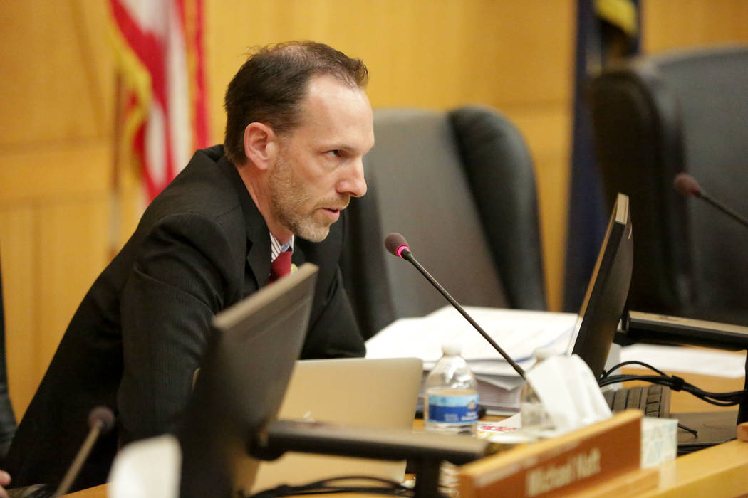 Clark County Commissioner Justin Jones addresses a speaker during a hearing on a proposal to bu ...