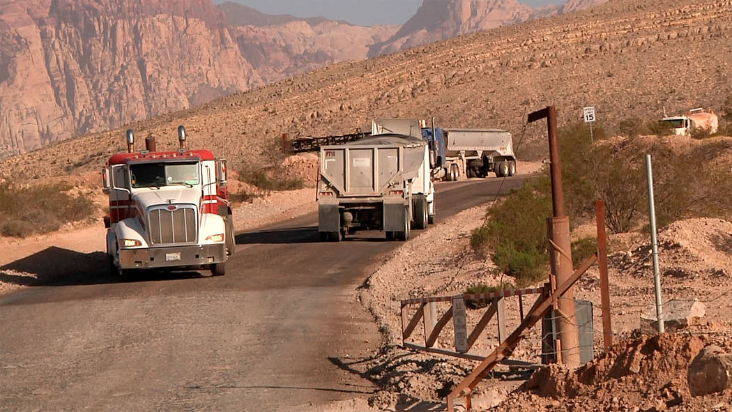 Trucks make their way up and down the road to Blue Diamond Hill Gypsum Mine where developers wa ...
