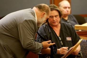 Alleged casino con man Mark Georgantas speaks to his new attorney Joseph Gersten at the Regiona ...