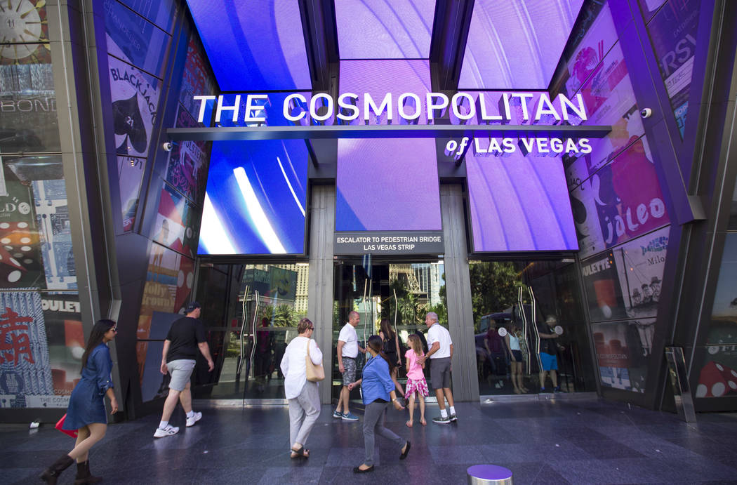 People walk outside The Cosmopolitan of Las Vegas on The Strip, Thursday, May 31, 2018. Richard ...