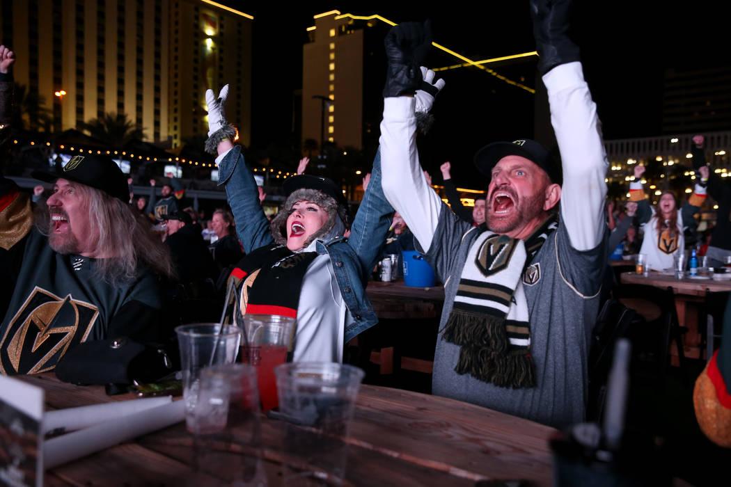 Vegas Golden Knights fans, from left, Rich Michalik, of Las Vegas, Jayne Post and her husband ...