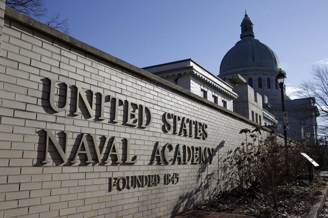 A sign stands outside of an entrance to the U.S. Naval Academy campus in Annapolis, Md., Thursd ...