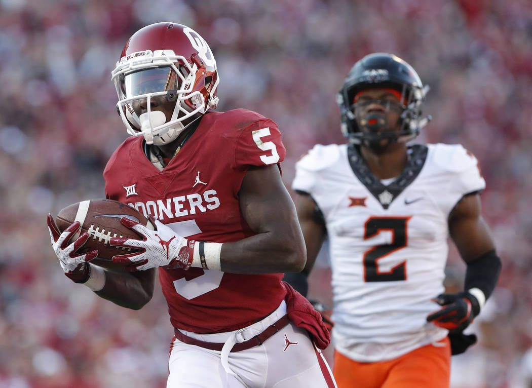 FILE - In this Nov. 10, 2018, file photo, Oklahoma wide receiver Marquise Brown (5) runs in for ...