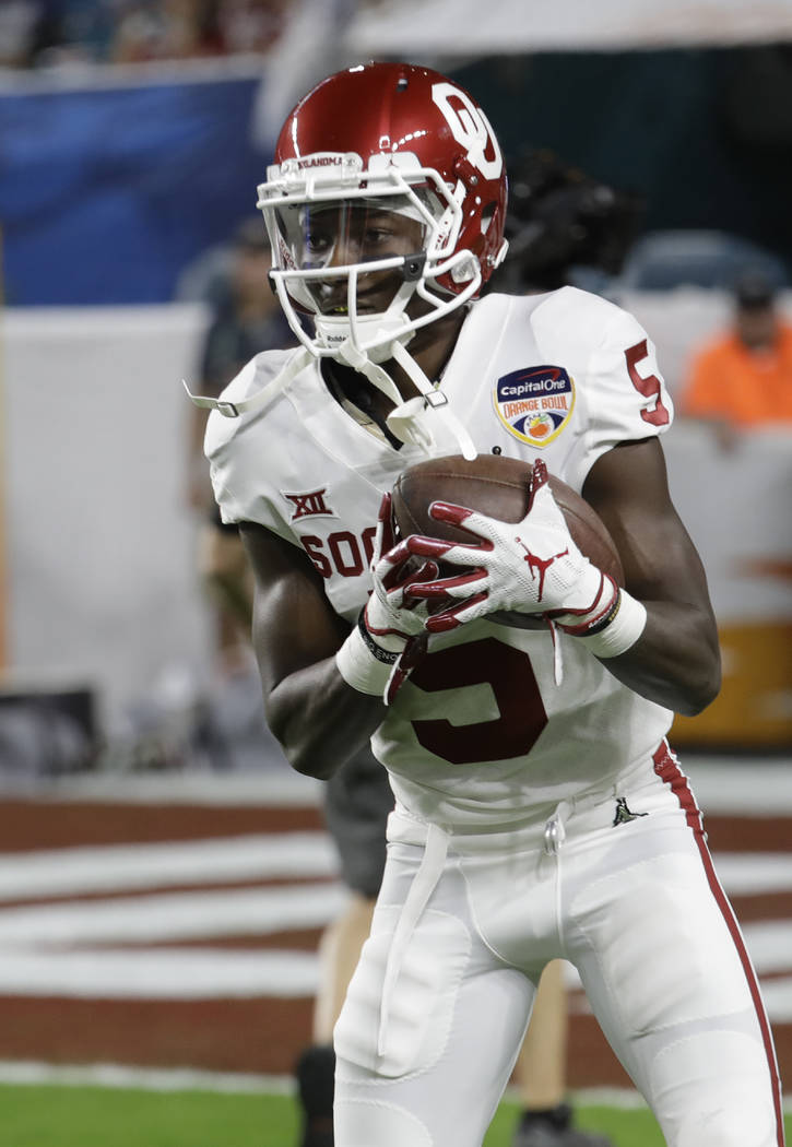 Oklahoma wide receiver Marquise Brown (5) warms up before the Orange Bowl NCAA college football ...